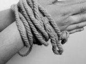 HN, bound wrists